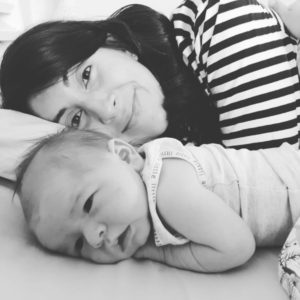 Mum and baby lying in bed