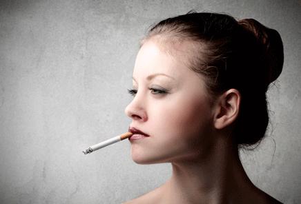A woman smoking a cigarette.