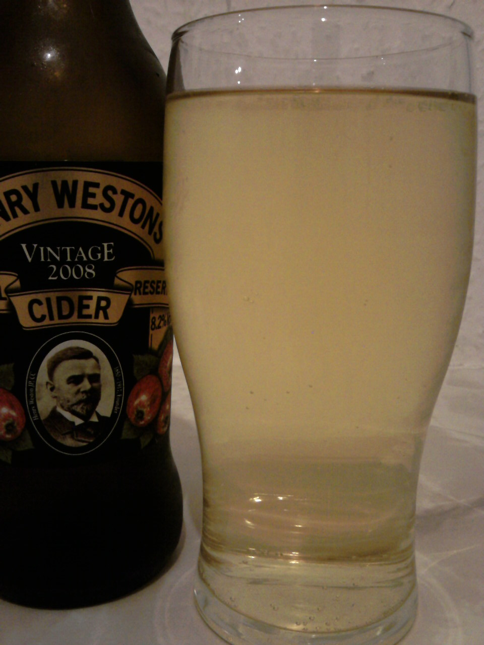 Henry Westons Vintage Special Reserve Cider poured into a glass