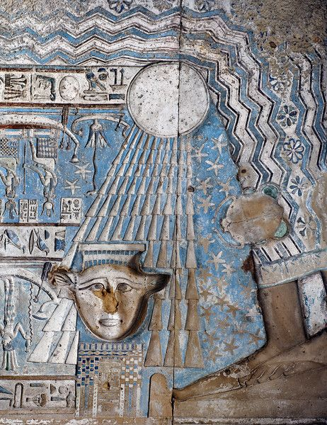 [EGYPT 29528]'Birth of the sun in Hathor Temple at Dendera.'	The rising sun is born from the lap of sky goddess Nut on the astronomical ceiling in the outer hypostyle hall of the Hathor Temple at Dendera. The ceiling consists of seven separate strips but here we are looking at a detail of the EASTERNMOST STRIP. The entire strip is enveloped by the outstretched body of the sky goddess Nut and her feet are visible in the right lower corner of this picture. The wave pattern on Nut's dress symbol