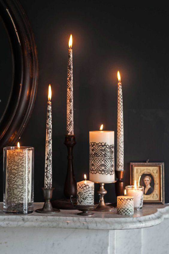 Lace Wrapped Candles - paint lace with nonflammable black paint and then roll the candle in it to pick it up