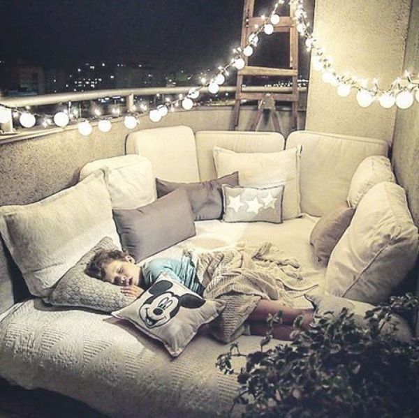 could get a futon, add lots of pillows = spot for kids to snuggle while watching movies