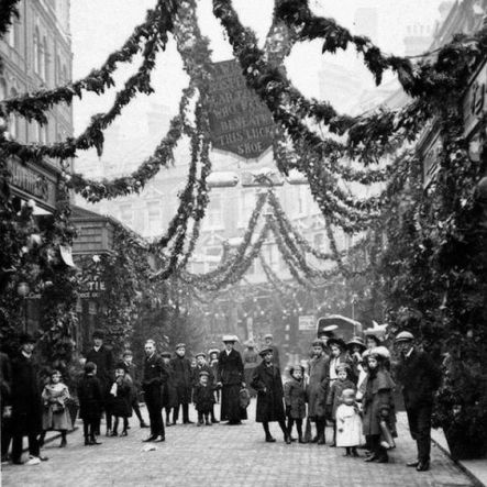 An Edwardian Christmas in Brixton, England, ca. 1908. Electric Avenue in Brixton was once a popular destination for Christmas shopping.…
