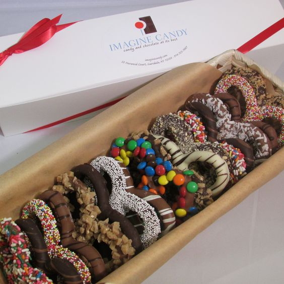 """Described by Westchester Magazine as """"The Rolls-Royce of chocolate covered pretzels"""", these gourmet dark, milk, or white chocolate pretzels are available in sensationally simple and/or embellished with delicious toppings."""