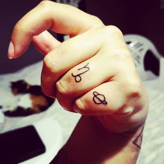 Capricorn and saturn tattoo