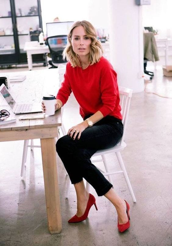 Love the pop red sweater with black pant.