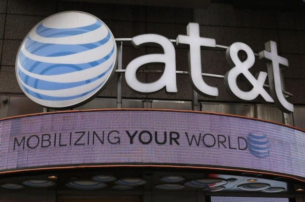 © Reuters. AT&T, H&R Block slide in pre-market, Netflix, Time Warner gain