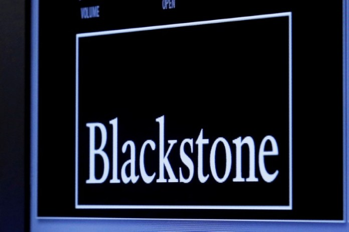© Reuters. FILE PHOTO - The logo of Blackstone Group is displayed at the post where it is traded on the floor of the New York Stock Exchange