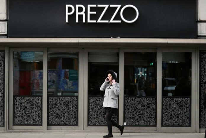 © Reuters. FILE PHOTO: A woman walks past a Prezzo restaurant in London