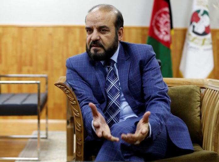 © Reuters. Gula Jan Abdul Badi Sayad chairman of Independent Elections Commission (IEC) of Afghanistan speaks during an interview in Kabul
