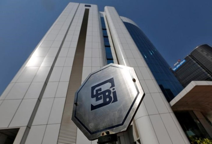 © Reuters. The logo of the Securities and Exchange Board of India (SEBI) is pictured on the premises of its headquarters in Mumbai