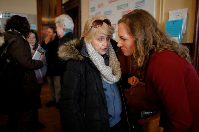 © Reuters. FILE PHOTO: Democratic candidate for the U.S. Congress Alexandra Chandler talks to a voter after the Greater Haverhill Indivisible candidates forum in Haverhill