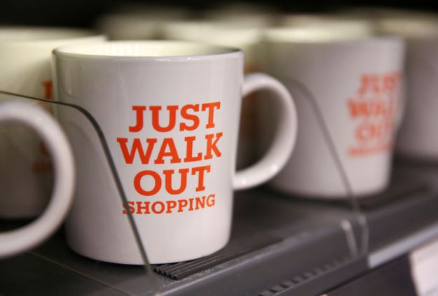 © Reuters. FILE PHOTO: Mugs that advertise the store's convenience are for sale in the new Amazon Go store in Seattle