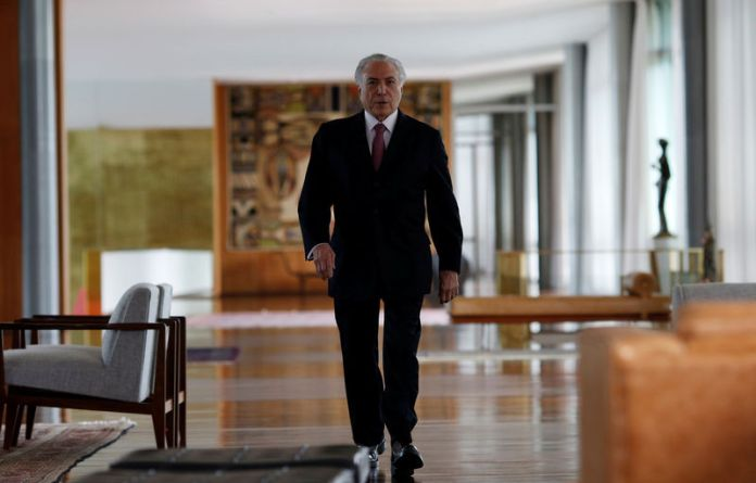 © Reuters. Brazil's President Michel Temer arrives for a breakfast with foreign media at Alvorada Palace in Brasilia