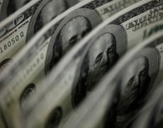 Dollar set for best weekly gain in two months on 'galvanizing' forces By Reuters