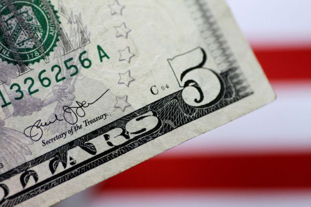 © Reuters. Illustration photo of a U.S. five dollar note