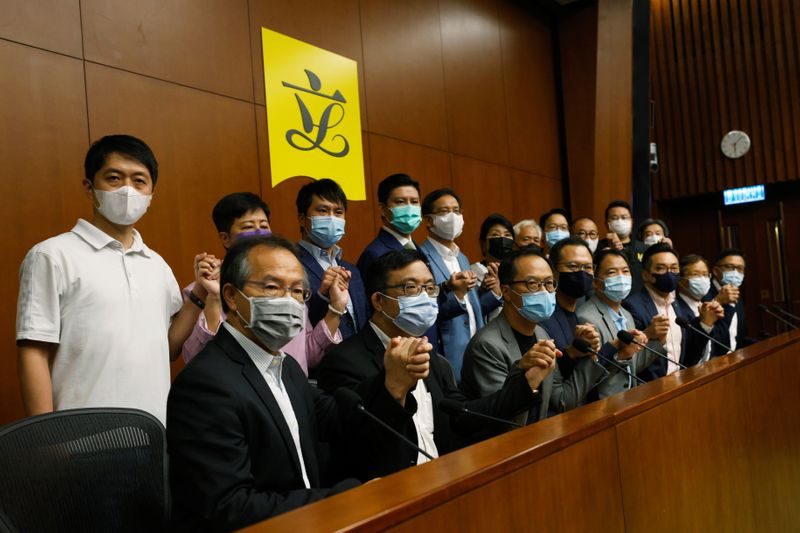 Hong Kong pro-democracy legislators threaten mass resignations By Reuters