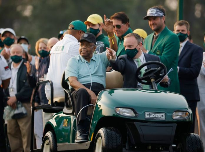 Golf-Johnson launches Masters title defense with opening bogey