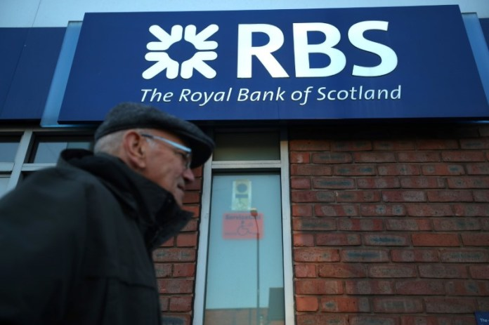 © Reuters. A person walks past a branch of RBS bank in Nottingham