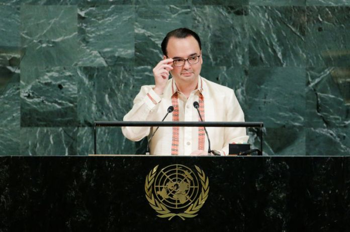 © Reuters. FILE PHOTO: Philippine Foreign Affairs Secretary Cayetano addresses the 72nd United Nations General Assembly at U.N. headquarters in New York