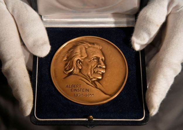 © Reuters. FILE PHOTO: The Albert Einstein Award displayed ahead of auction at Christie's in London