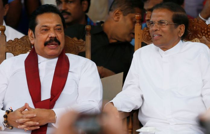 © Reuters. Sri Lanka's newly appointed Prime Minister Rajapaksa and President Sirisena talk during a rally near the parliament in Colombo