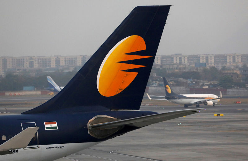 © Reuters. FILE PHOTO: A Jet Airways plane is parked on the runway at the Chhatrapati Shivaji International airport in Mumbai, India