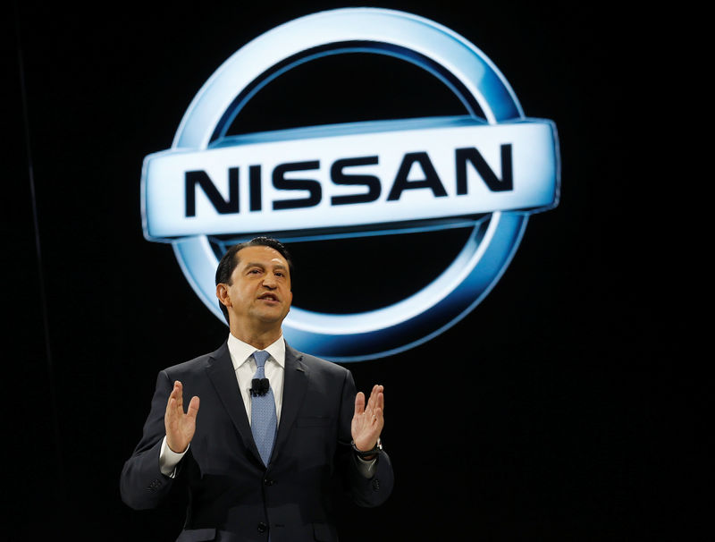 © Reuters. FILE PHOTO: Jose Munoz, Chairman of Nissan North America, speaks during the North American International Auto Show in Detroit