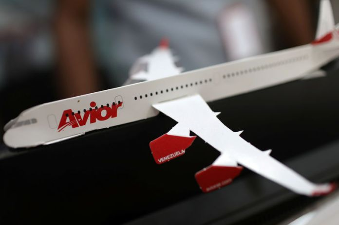 © Reuters. The corporate logo of Avior Airlines is seen in a scale model airplane at their office in Caracas