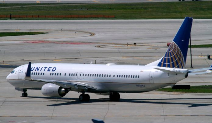 © -. FILE PHOTO: A United Airlines plane with the Continental Airlines logo on its tail, taxis to the runway at O'Hare International airport in Chicago