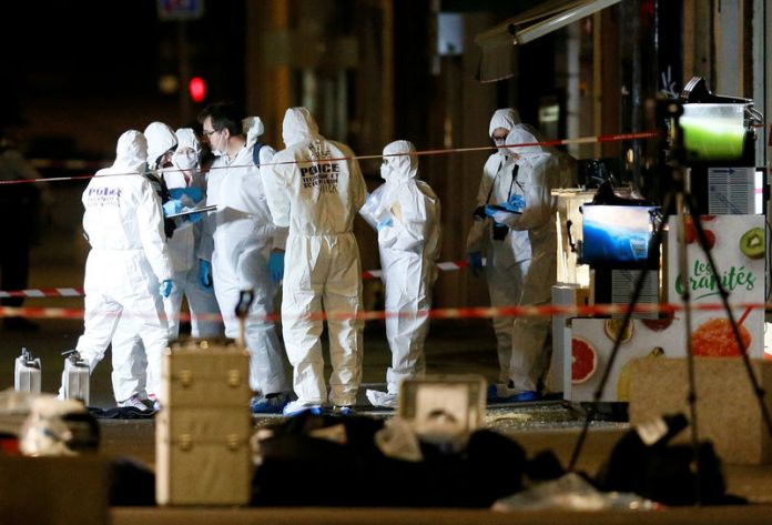 © -. FILE PHOTO: Forensic officers inspect the site of a suspected bomb attack in central Lyon