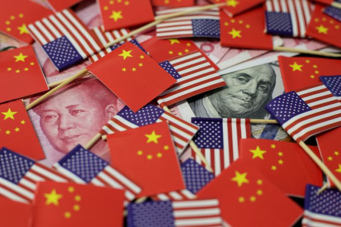 © -. FILE PHOTO: Illustration picture showing U.S. dollar and China's yuan banknotes