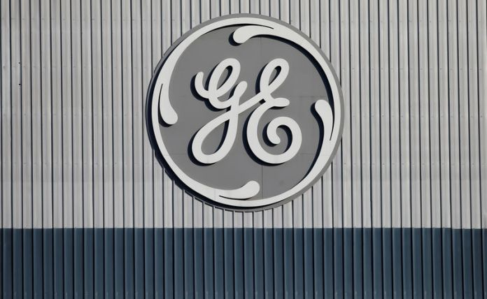 © -. FILE PHOTO: The logo of US conglomerate General Electric is pictured at the company's site of its energy branch in Belfort