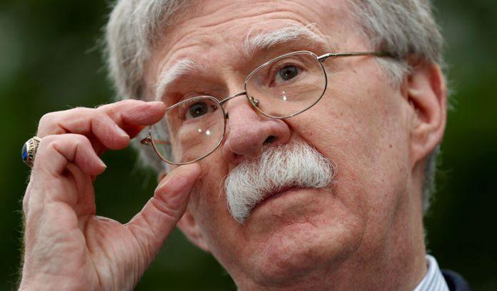 © -. FILE PHOTO: Bolton speaks at the White House in Washington