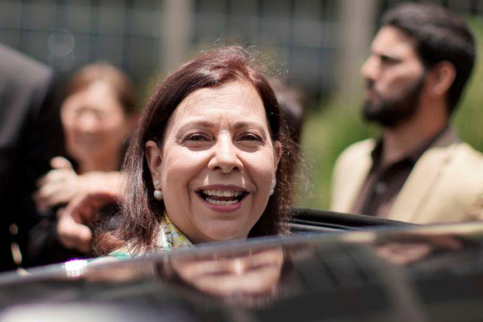 © -. Venezuelan opposition representative Belandria smiles after news conference in Brasilia