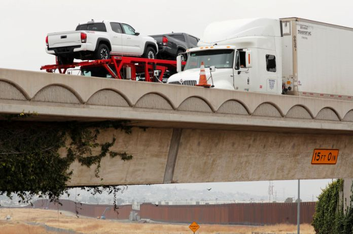 © -. Transport trucks carrying Toyota trucks from Mexico cross into the United States at the Otay Mesa border crossing in San Diego, California