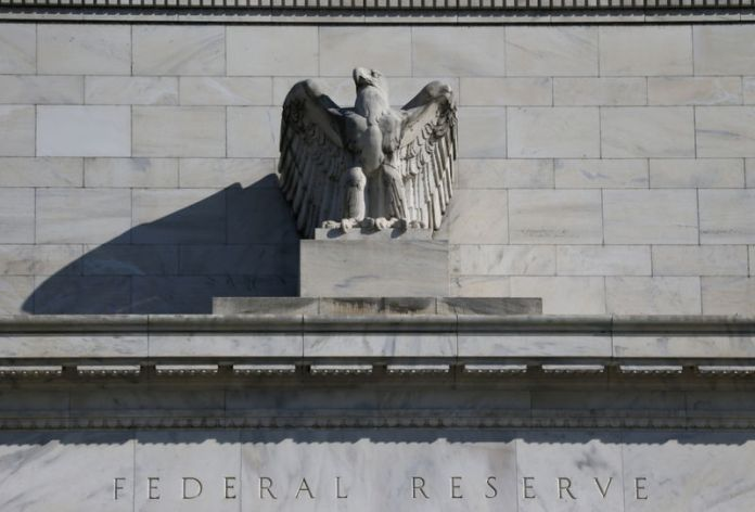 © -. FILE PHOTO: Federal Reserve Board building on Constitution Avenue is pictured in Washington