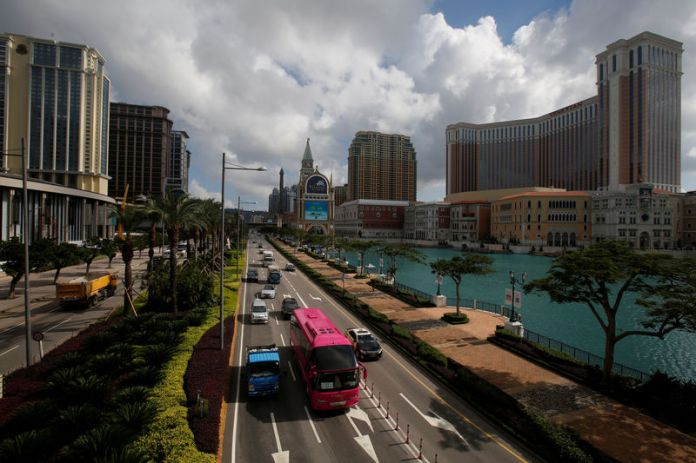 © -. FILE PHOTO: Traffic flows past gaming resorts at Cotai Strip in Macau