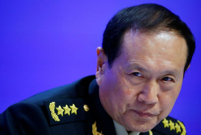© -. Chinese Defense Minister Wei Fenghe attends the IISS Shangri-la Dialogue in Singapore
