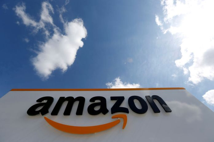 © -. FILE PHOTO: The logo of Amazon is seen at the company logistics centre in Boves