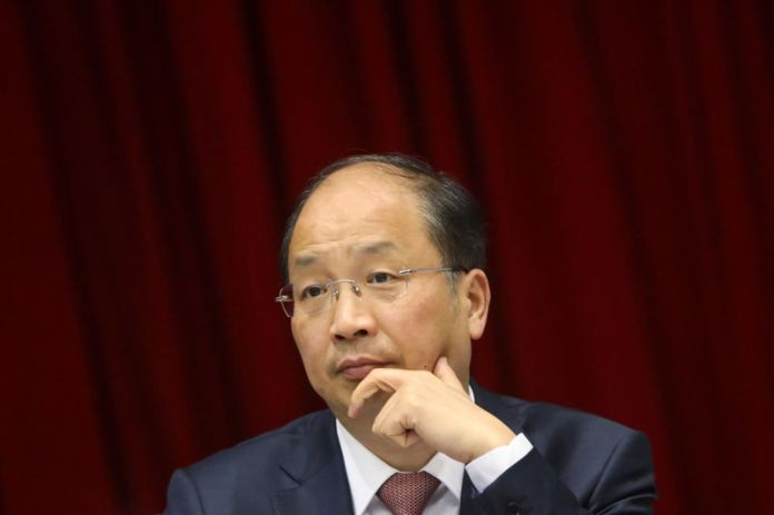 © -. Yi Huiman, chairman of China Securities Regulatory Commission, attends a meeting of Fujian delegation on the sidelines of the National People's Congress (NPC), at the Great Hall of the People in Beijing