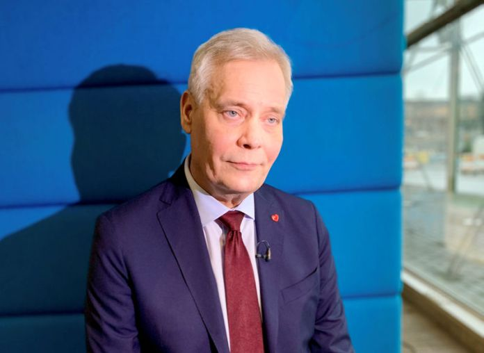 © -. FILE PHOTO: Social Democratic Party leader Antti Rinne listens during an interview in Helsinki