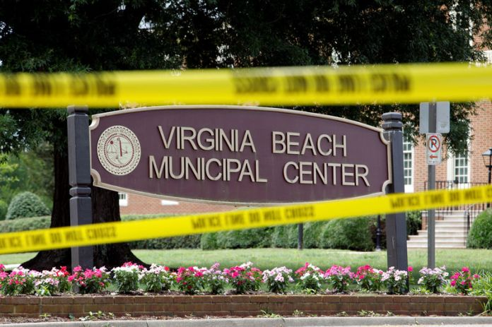 © -. FILE PHOTO: Police tape frames a sign at one of the entrances to the municipal government complex where a shooting incident occurred in Virginia Beach, Virginia