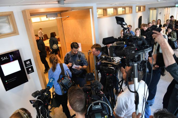 © -. The Media gathers at the Uppsala District Court, where the detention hearing regarding WikiLeaks' founder Julian Assange is being held, in Uppsala