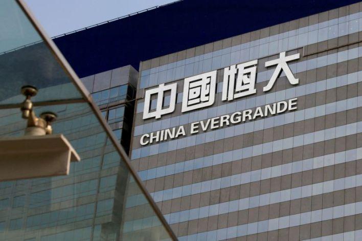 China Evergrande vows to resolve debt risks after regulators' warning