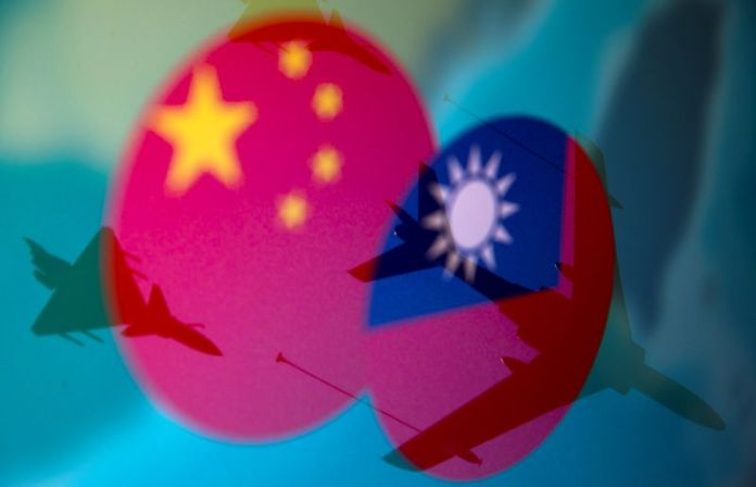 Taiwan warns it needs to be on alert to 'over the top' China