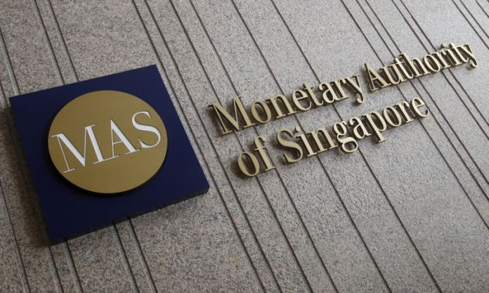 Singapore's central bank tightens policy in surprise move