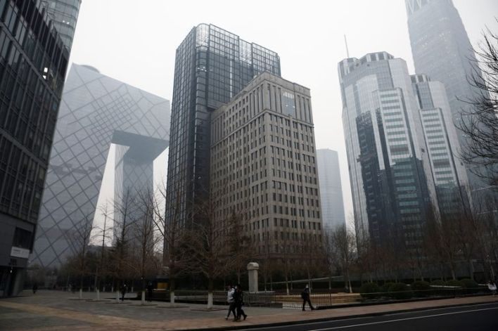 China's top banking regulator warns of bad debt, local real estate bubbles