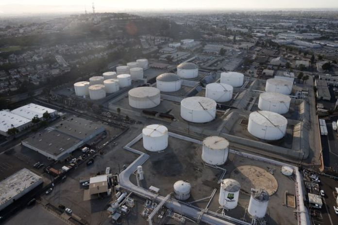 Oil retreats, but heads for third weekly rise on demand recovery