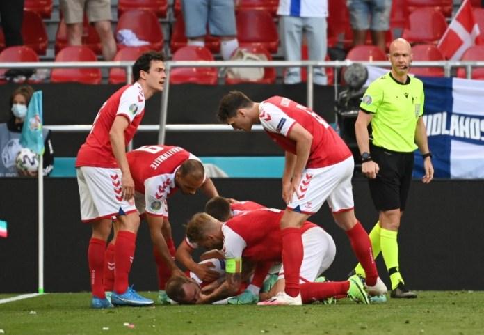 Soccer-Denmark's Eriksen 'awake' after collapsing during Euro 2020 match